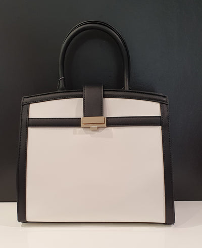 Binko by Vera May is a larger day bag with long adjustable shoulder strap, easy access with internal pockets. A classic black and white bag for every day use with enough room for all your essentials. Faux Leather