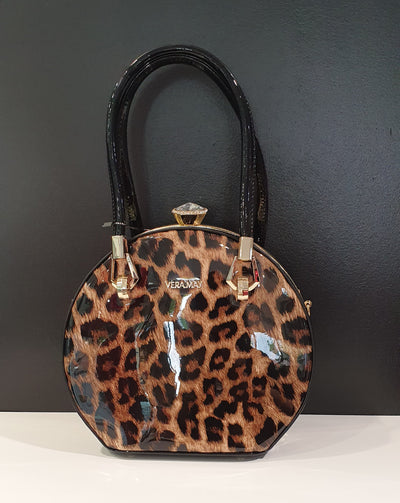 Boho by Vera May is a fantastic round bag very stylish look, with a gorgeous large diamante clasp. This bag has a great easy opening and long strap, for easy use. The leopard print also sets it apart from the norm.  Also available in Burgundy and Black