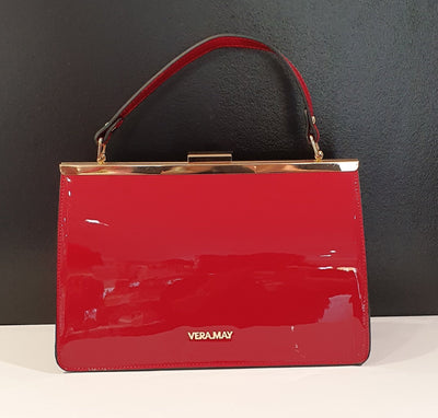 Vera May Modesto is a very 50's style handbag, suit any evening attire or just a lovely style day bag. It is faux patent leather with long strap also.