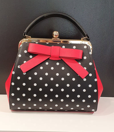 Lisa by Vera May is a super cute retro, handbag with room and style, suitable for any occasion or just add a bit of color to your outfit. Comes with a long strap , and the BOW!