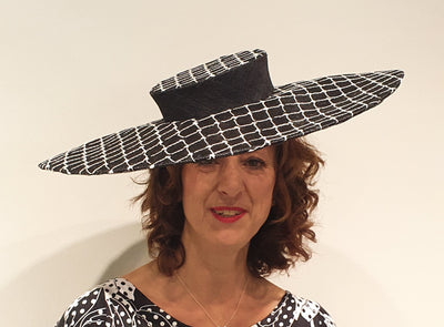 This stunning sinamay hat, in black and white is a statement for an occasion such as wedding, race day, or the royal garden party.  Made in London this is the only one we have available, so if your looking for that special piece to add to your collection, it's a must see!