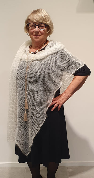 Beautiful kid Mohair poncho Made in New Zealand, these are soft and so warm.   Throw over a simple top or dress to create a layer of warmth and style.   Available in many soft pastel colours , made to order available.