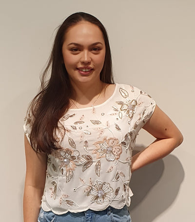 Pretty beaded and sequin short top, great with pants and skirts, to add glamour for an occasion! The colours are soft pastels on white. Available in 12/14