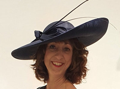 This gorgeous dark navy hat is the perfect accessory for that wedding or race day!   Great coverage from the bright and hot sun.   Only 1 available