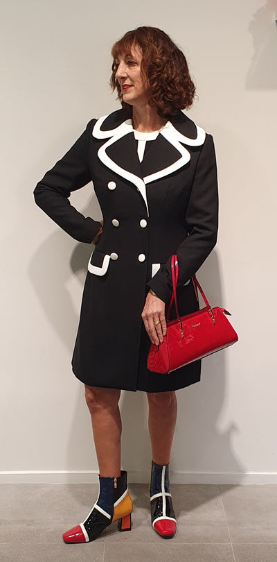 Classic !960's style double breasted long line coat, is great for work. Fully lined and tailored waist, a very striking look with boots and matching handbag!