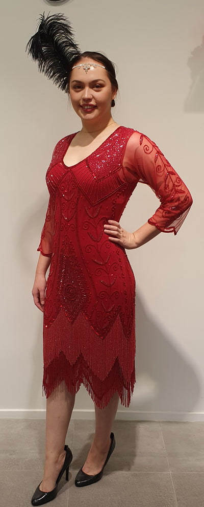 This absolutely glamorous, fiery red 1920's gatsby style dress. Needs no other accessories except you! This dress is made up of beads, sequins and a fine mesh, which has some give for comfort and a matching under slip. Wearing it transports you to another time, and makes you want to dance! Available in 16 Available in …