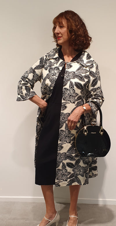 Gloria coat is a Vintage Addiction design, made in various fabrics depending on the season. A classic 50's free from a more fitted style makes this coat easy to wear over dress or pants. Wide arms also make it non restrictive. Available in S, M, L . Request what is in stock changes frequently.