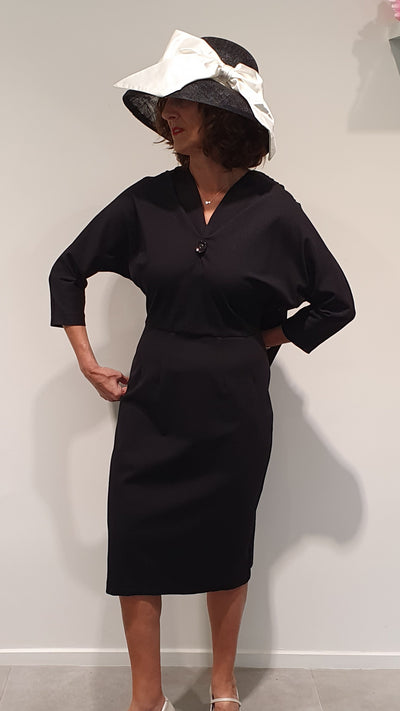 Giselle, this rather provocative 50's fitted dress, makes heads turn. Made with Ponte it curves nicely to the figure, with bat wing sleeves and a draping back for extra drama! A must have for that confident women in you. Available in size 14 Able to order in any size.