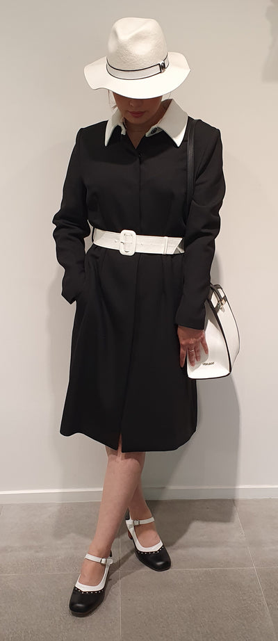 Great Classic black and white 1960's coat by Marmalade, is very stylish, and warm. Striking detail in the white collar and belt makes this a great peice for work or play . Match with boots for a cool look. Available in 8/10 or 14/16