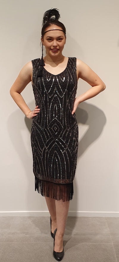 1920's Black and silver beaded and sequin Gatsby style dress, with some stretch a great evening or event dress. Accessories will make the perfect addition for a themed party, feathers, long beads. Available in Snl and Med