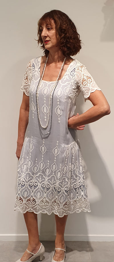 1920's Silk sage under a cream silk lace, beautiful soft and cool fabric, for summer. This dress is perfect for a wedding or Art Deco event.   Accessories can add to the finish of this very classic and feminine style, which wont date.   Available in size 12