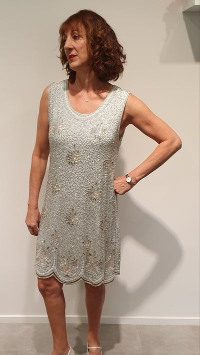 Gorgeous grey fully beaded 20's style dress, only 1 available. It has lovely detailing in the floral beaded work, soft pastel Rose's. Perfect for a evening cocktail party, or any party! It is a size 10 and only 1 available