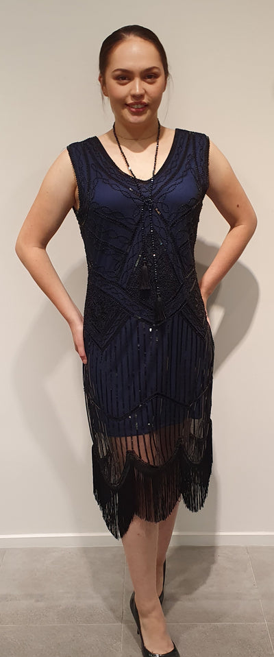 Navy and black beaded and sequins, super cute 20's style. Light with some stretch great for dancing with a fringe bottom. Easy to accessorize with feathers for that theme party! Available in Navy Sml and Med
