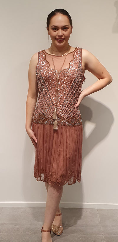 This deep blush 1920's dress is a beautiful beaded and sequined example of that era, it has a sheer plunging neck and back. Perfect for special occasions or a party dress, with lovely scalloped edge hemline. A versatile wardrobe piece. Available in Med