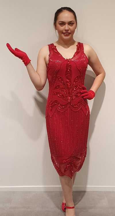 1920's Red gatsby dress, beads and sequins make this a great party dress. Sleeveless with an under slip comfortable and glamorous without being long and formal. This makes it a great dress for many occasions, even a Xmas party. Available in 10-12 But can order other sizes.