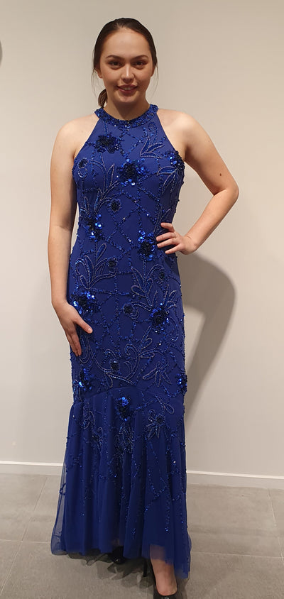 Stunning royal blue soft mermaid style. This dress features a halterneck, with slightly longer length at the back.Fully sequined front and back, with a lovely soft curve of the hips,creating a feminine shape.Beautiful colour .