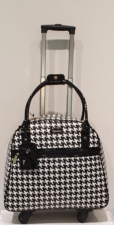 Poland by Vera May is a gorgeous houndstooth, overnight/ travel bag or work. Very stylish and easy to move with four wheels and adjustable height handle.  Spacious with pockets, well designed and made, don't carry laptop, lunch, bag, and everything else to work, pull it in one cool bag.  Measurements L18 x H15 not included handles) and W 9 inches.