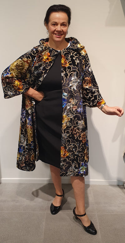 Gloria by Vintage Addiction is a beautiful 1950's style coat, made in New Zealand.   This is a really beautiful velvet floral fabric, with gold and vibrant blues.  This is the only one left available in this fabric, size L