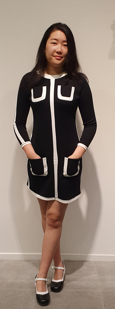 This amazing 60's recreation is a statement piece. Classic black and white knit fabric makes this not only stylish but comfortable.   Accessorize with some great boots, tights and your set for a cool winter's day!   Made and designed in Europe this is a limited range .   Sizes 6, 10  left