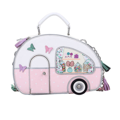 Sweetie caravan box bag is adorable, from the tassels on the shoulder strap and retro curtains and turning wheels.. If you own a retro caravan its the perfect accessory. The door actually opens to reveal the Queens Corgis!   The double zip opening allows for easy access and shows off the fab Macaroons lining!