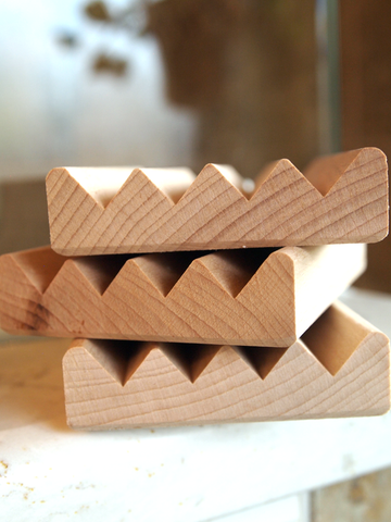 stack of wooden soap dishes