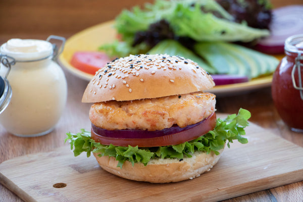 Organic Ocean shrimp burger plated on wood serving board
