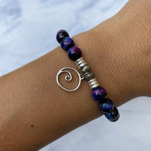 Load image into Gallery viewer, T. Jazelle Indigo Tigers Eye Stone Bracelet with Wave Sterling Silver Charm