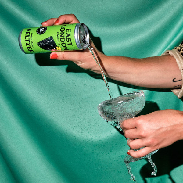 East London Liquor Lime and Vodka Seltzer Can Pouring