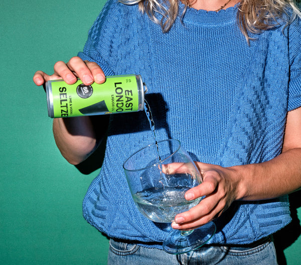 East London Liquor Lime and Vodka Seltzer Can Pouring Two
