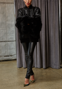 Woman wearing Norisol Ferrari black leather pants
