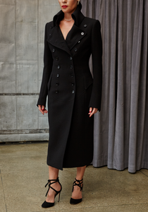 Woman wearing Norisol Ferrari black coat