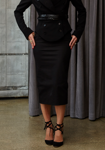 Woman wearing Norisol Ferrari black pencil skirt