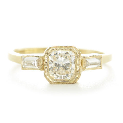 18KYG bezel set diamond ring with side baguettes