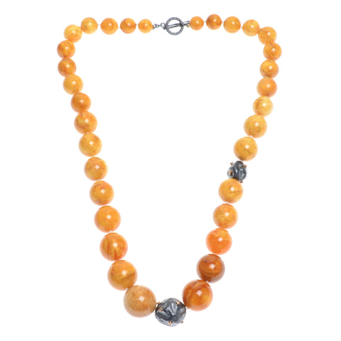 "22"" light amber bead necklace with two diamond encrusted black pearls"