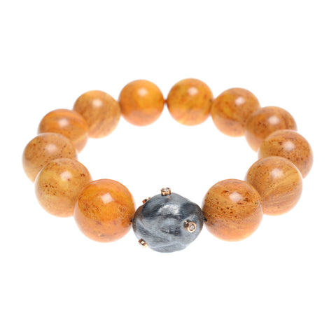 Light amber bead bracelet with one diamond encrusted black pearl