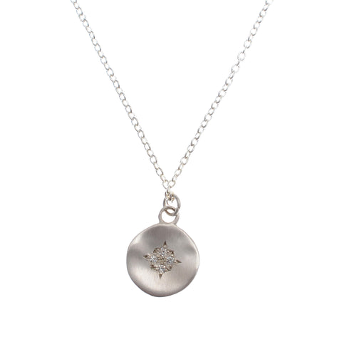 "Small disc pendant of sterling silver and with inlaid diamonds on a sterling 16 "" chain"