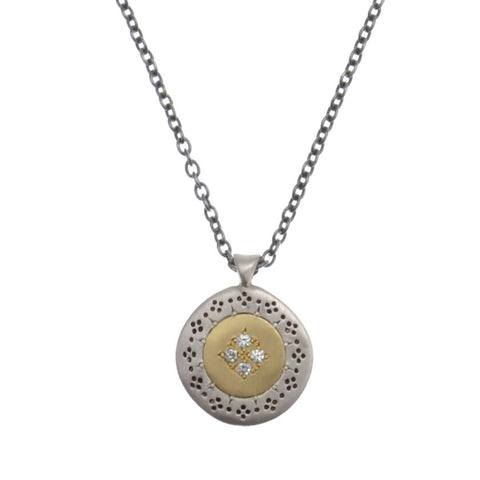"Small disc pendant of sterling silver and 14kyg with inlaid diamonds on oxidized 16 "" chain"