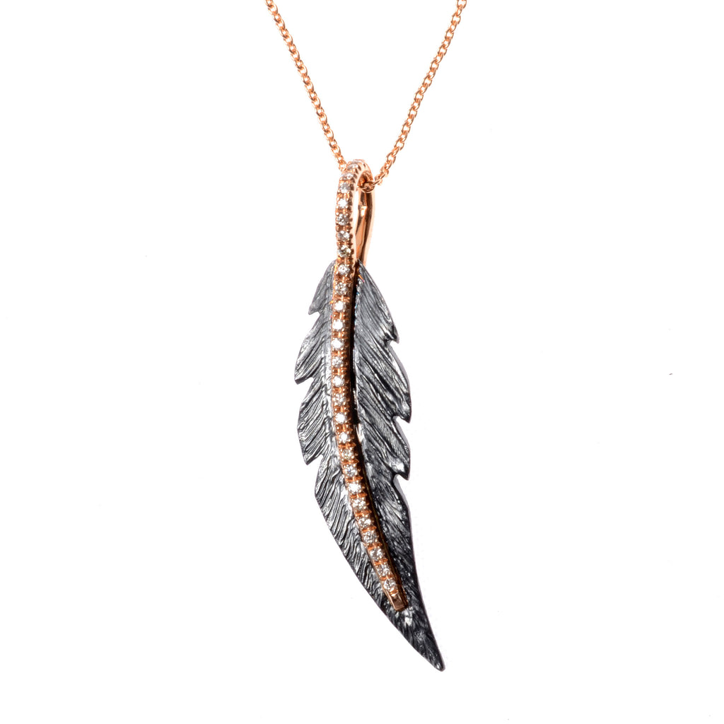 "Small sterling silver feather necklace with diamonds down the spine on a  16"" 18K rose gold chain"