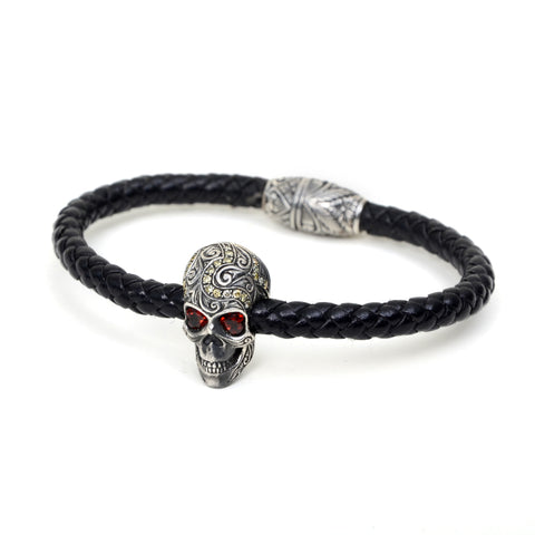 "Leather bracelet with skull ornament with garnet eyes, 9"" circumference"