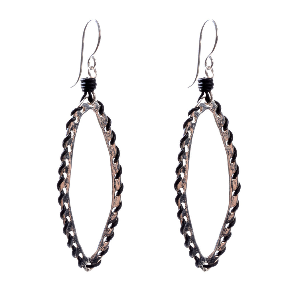 Elongated stitched sterling silver pointed hoops with your choice of brown or black leather