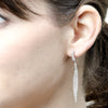 Woven 18kyg modified hoop earring with raw diamonds
