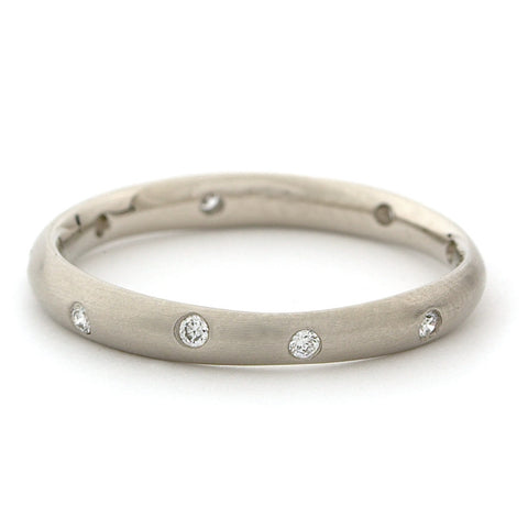 Anne Sportun wonky band 9x.01 ct diam throughout