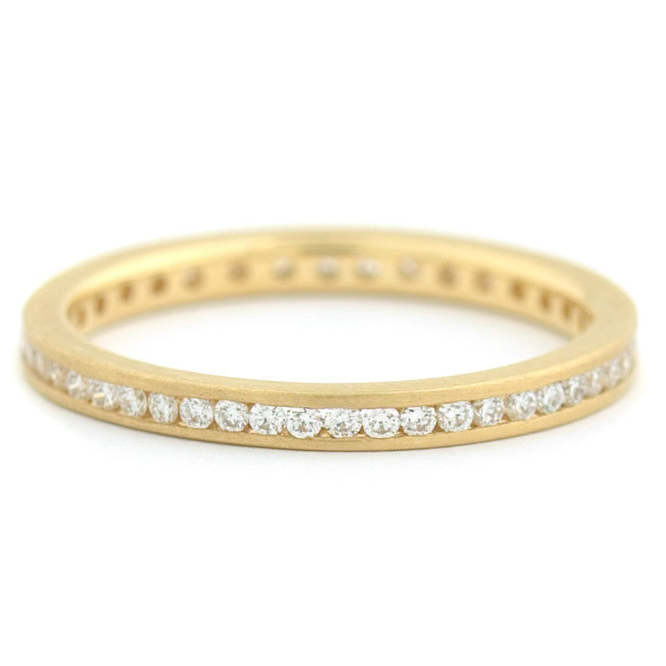 Anne Sportun mini channel set diamonds on half of band