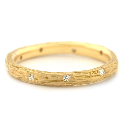 Anne Sportun 18kyg bark finish band with 9x.01 ct diamonds