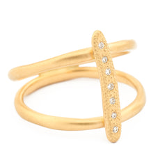 Anne Sportun 18kyg stick, two bands with 7x.005RBCs (round brilliant cut) diamonds for .035tcw