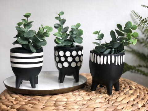 trio of pots on legs
