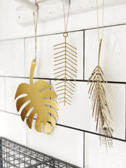 Trio of hanging gold iron leaf decorations