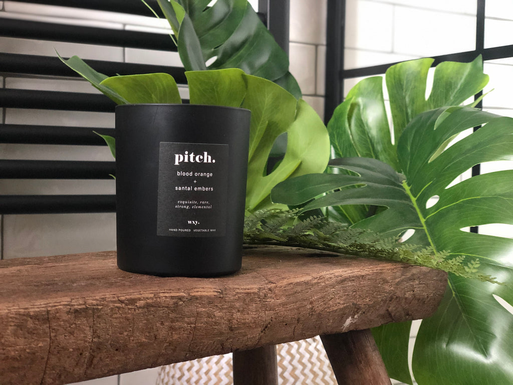Boxed black scented candle; PITCH