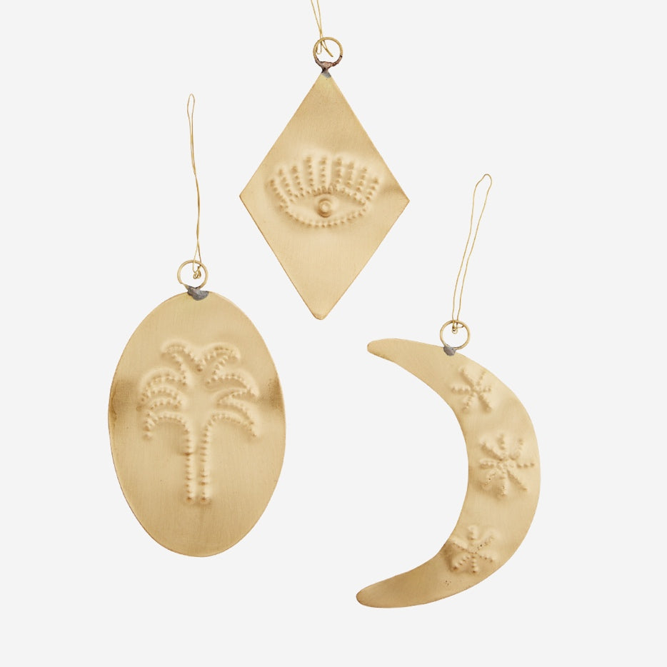 Trio of hanging brass decorations