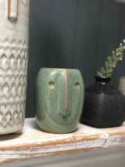 Stoneware pot with face imprint